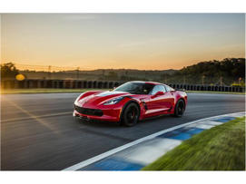 a car parked on the side of a road: 2018 Chevrolet Corvette