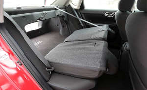 a group of luggage sitting on top of a car: Cargo Space and Storage