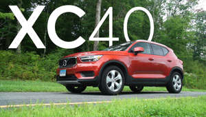 a car parked in front of a sign: 2019 Volvo XC40 Quick Drive