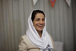 Iranian lawyer Nasrin Sotoudeh smiles at her home in Tehran on September 18, 2013, after being freed following three years in prison. Sotoudeh told AFP she was in 'good' physical and psychological condition, and pledged to continue her human rights work. Her release came a week before Irans new moderate President Hassan Rowhani, who has promised more freedoms at home and constructive engagement with the world, travels to New York to attend the United Nations General Assembly.  AFP PHOTO/BEHROUZ MEHRI        (Photo credit should read BEHROUZ MEHRI/AFP/Getty Images)