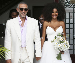 French actor Vincent Cassel and model Tina Kunakey smile as they leave the town hall after their wedding Friday, Aug. 24, 2018 in Bidart, southwestern France. (AP Photo/Bob Edme)