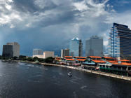 The Coast Guard and local law enforcement patrol the St. John's River outside Jacksonville Landing as seen from a view from Main Street Bridge in Jacksonville, Fla., Sunday, Aug. 26, 2018. Florida authorities are reporting multiple fatalities after a mass shooting at the riverfront mall that was hosting a video game tournament. (AP Photo/Laura Heald)