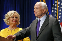 FILE - In this Nov. 8, 2016 file photo, Sen. John McCain, R-Ariz., accompanied by his wife Cindy McCain, pauses after speaking in Phoenix. A Trump administration official says that Cindy McCain is likely to take on a prominent State Department role. (AP Photo/Ross D. Franklin, File)