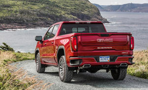 a red truck driving down a dirt road: The 2019 GMC Sierra 1500 Is No Longer Just a Pricier Chevy Silverado