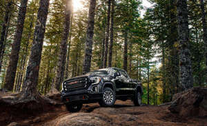 a car parked in a forest: The 2019 GMC Sierra 1500 Is No Longer Just a Pricier Chevy Silverado