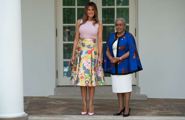 Slide 3 of 161  US First Lady Melania Trump walks with Margaret Kenyatta (R 18af6b623924e