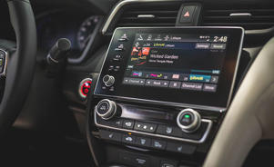 a black car on display: Audio and Infotainment