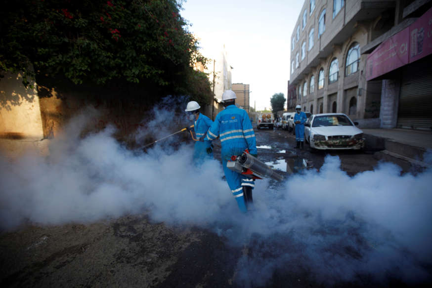 FILE - Public health workers spray insecticide amid fears of a new cholera outbreak in Sanaa, Yemen June 7, 2018.