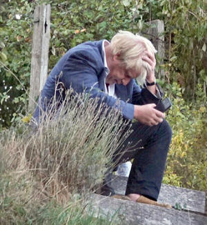 Boris Johnson (pictured in his Thame garden) last night sparked outrage by saying Theresa May's Brexit strategy had put Britain in a suicide vest and given detonator to Brussels