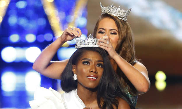 Miss New York Nia Franklin reacts after being named Miss America 2019, as she is crowned by last year's winner Cara Mund, Sunday, Sept. 9, 2018, in Atlantic City, N.J. (AP Photo/Noah K. Murray)