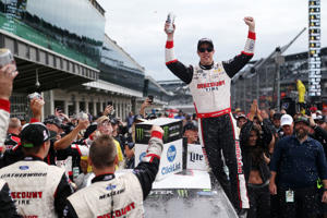 Brad Keselowski, driver of the Discount Tire Ford, celebrates in victory lane after winning the Monster Energy NASCAR Cup Series Big Machine Vodka 400 at the Brickyard at Indianapolis Motor Speedway on Sept. 10 in Indianapolis, Indiana.