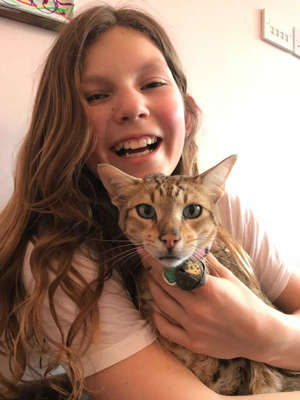 Tabitha Brown pictured with her cat that was found mutilated