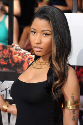 Rapper and R&B singer Nicki Minaj arrives at the 2014 MTV Movie Awards at Nokia Theatre L.A. Live in Los Angeles, USA, 13 April 2014. Photo: Hubert Boesl/dpa -NOA?WIREA?SERVICE/KEINA?BILDFUNK- | usage worldwide   (Photo by Hubert Boesl/picture alliance via Getty Images)