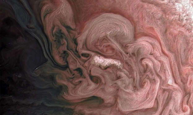 Slide 1 de 25: This image captures a close-up view of a storm with bright cloud tops in the northern hemisphere of Jupiter.