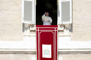 Pope Francis delivers his blessing as he recites the Angelus noon prayer from the window of his studio overlooking St. Peter's Square, at the Vatican, Sunday, Sept. 30, 2018. (AP Photo/Andrew Medichini)