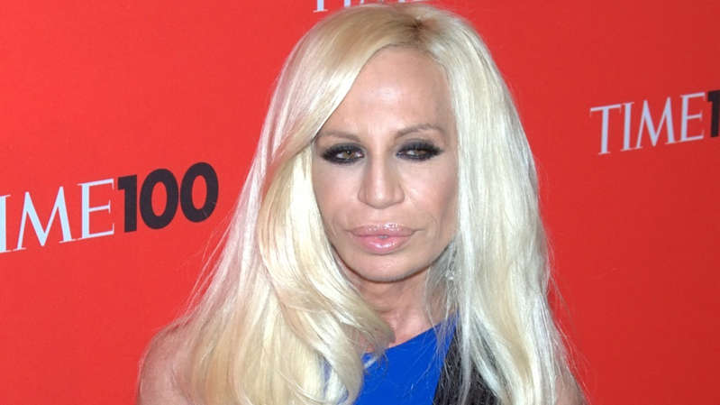 Donatella Versace wearing a blue shirt
