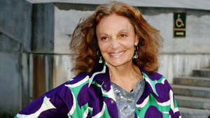Diane von Furstenberg wearing a purple shirt
