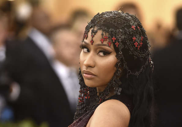 Nicki Minaj attends The Metropolitan Museum of Art's Costume Institute benefit gala celebrating the opening of the Heavenly Bodies: Fashion and the Catholic Imagination exhibition on Monday, May 7, 2018, in New York. (Photo by Evan Agostini/Invision/AP)
