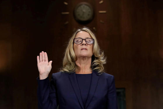 Slide 1 de 32: Christine Blasey Ford is sworn in before testifying the Senate Judiciary Committee in the Dirksen Senate Office Building at the Capitol Hill in Washington, DC, U.S., September 27, 2018. Win McNamee/Pool via REUTERS      TPX IMAGES OF THE DAY