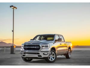 a yellow car parked on the side of a road: 2019 Ram 1500