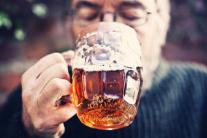 Man drinking traditional pint of real ale beer.