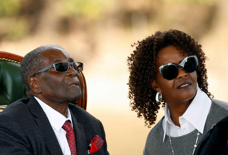 """Zimbabwe's former president Robert Mugabe and his wife Grace look on after addressing a news conference at his private residence nicknamed """"Blue Roof"""" in Harare, Zimbabwe, July 29, 2018. REUTERS/Siphiwe Sibeko"""