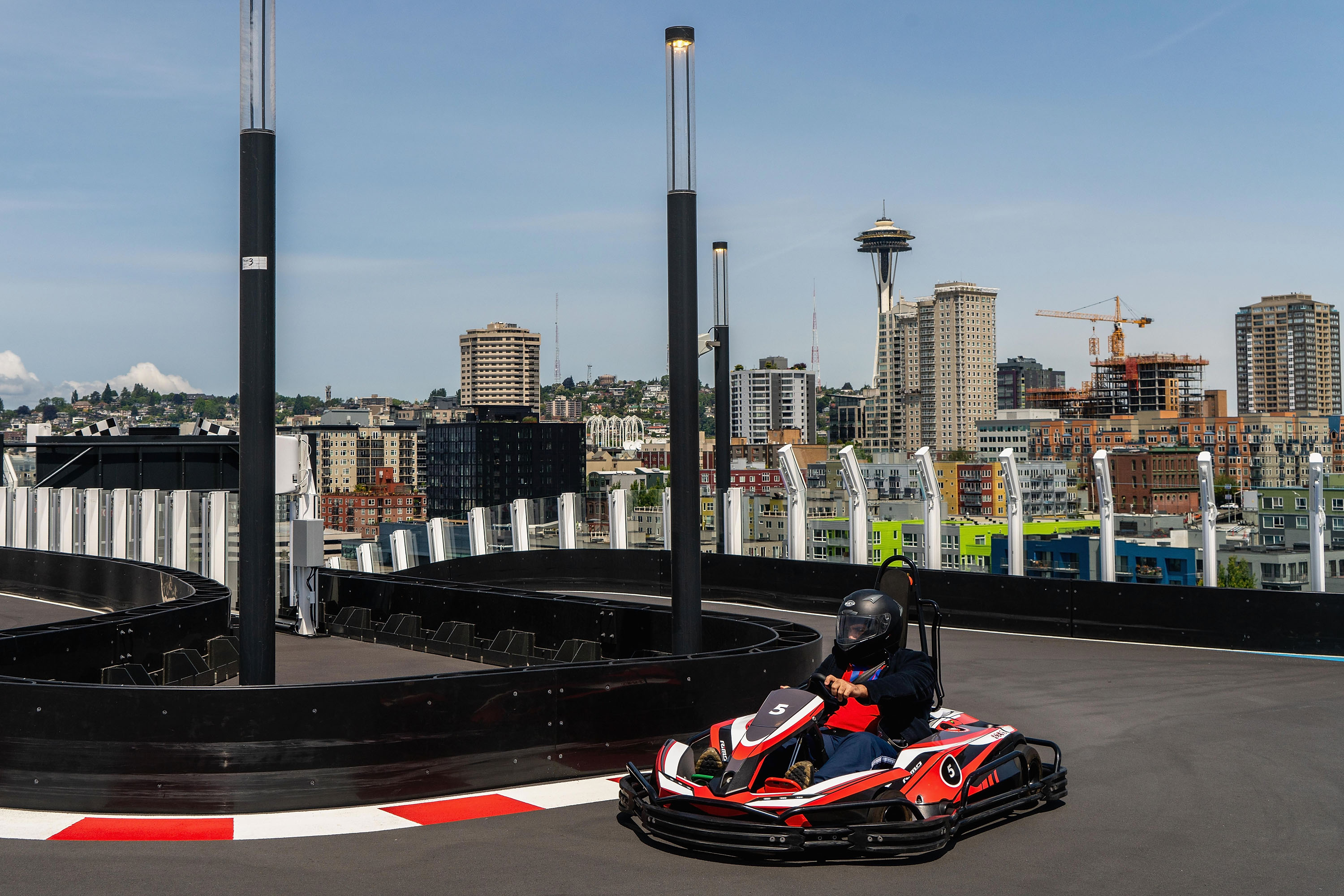 Slide 40 of 77: SEATTLE, WA - MAY 30: Guests race the two-level race track on board Norwegian Bliss with views of the Seattle skyline at Pier 66 on May 30, 2018 in Seattle, Washington.  (Photo by Suzi Pratt/Getty Images for Norwegian Cruise Line)