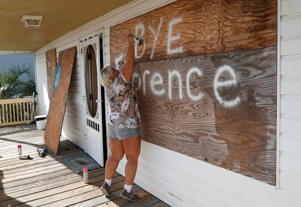 Lisa Evers of Oak Island decorates her storm shutters before evacuating her house ahead of the arrival of Hurricane Florence in Oak Island, North Carolina, U.S. September 12, 2018.  REUTERS/Randall Hill