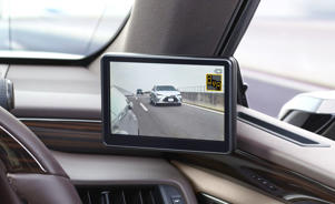 a desktop computer sitting on top of a car: Lexus ES side camera mirror screen