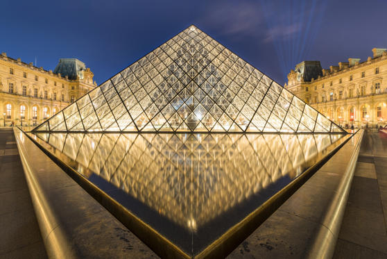 Slide 1 of 20: Louvre Pyramid at night