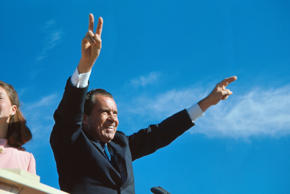 Richard Nixon gives his well-known two-armed victory salute during a campaign stop in El Paso. (Photo by © Bettmann/CORBIS/Bettmann Archive)