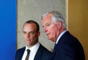 Britain's Secretary of State for Exiting the European Union, Dominic Raab and European Union's chief Brexit negotiator, Michel Barnier look on as they arrive for a media briefing at the EU Commission headquarters in Brussels, Belgium August 21, 2018. REUTERS/Francois Lenoir