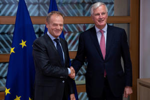 European Council President Donald Tusk poses with European Union's chief Brexit negotiator Michel Barnier ahead of meeting in Brussels, Belgium September 13, 2018. Francisco Seco/Pool via REUTERS
