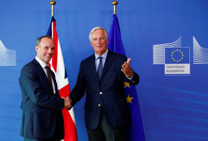 Britain's Secretary of State for Exiting the European Union, Dominic Raab shakes hands with European Union's chief Brexit negotiator, Michel Barnier as they pose for pictures after a media briefing at the EU Commission headquarters in Brussels, Belgium August 21, 2018. REUTERS/Francois Lenoir