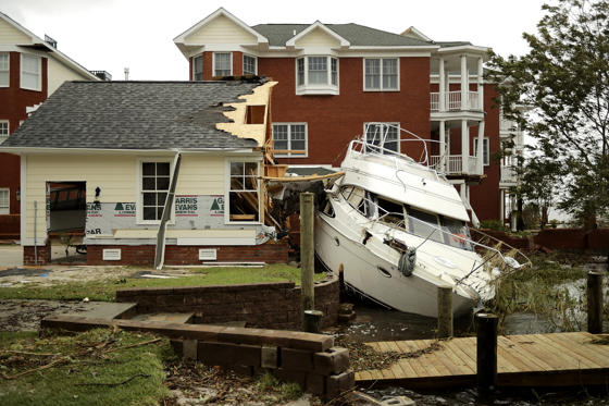 Slide 1 of 124: NEW BERN, NC - SEPTEMBER 15:  A boat lays smashed against a car garage, deposited there by the high winds and storm surge from Hurricane Florence along the Neuse River September 15, 2018 in New Bern, North Carolina. Hurricane Florence made landfall in North Carolina as a Category 1 storm Friday and at least five deaths have been attributed to the storm, which continues to produce heavy rain and strong winds extending out nearly 200 miles.  (Photo by Chip Somodevilla/Getty Images)