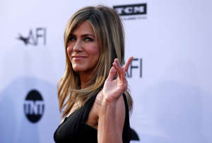 CAPTION: Actor Jennifer Aniston waves at the 46th AFI Life Achievement Award Gala in Los Angeles, California, U.S., June 7, 2018. REUTERS/Mario Anzuoni