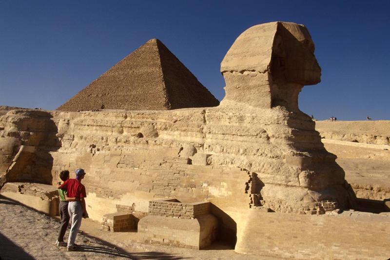 Egypt, Cairo, Giza District, Sphinx, face of Pharaoh Khephren with Tourist Couple