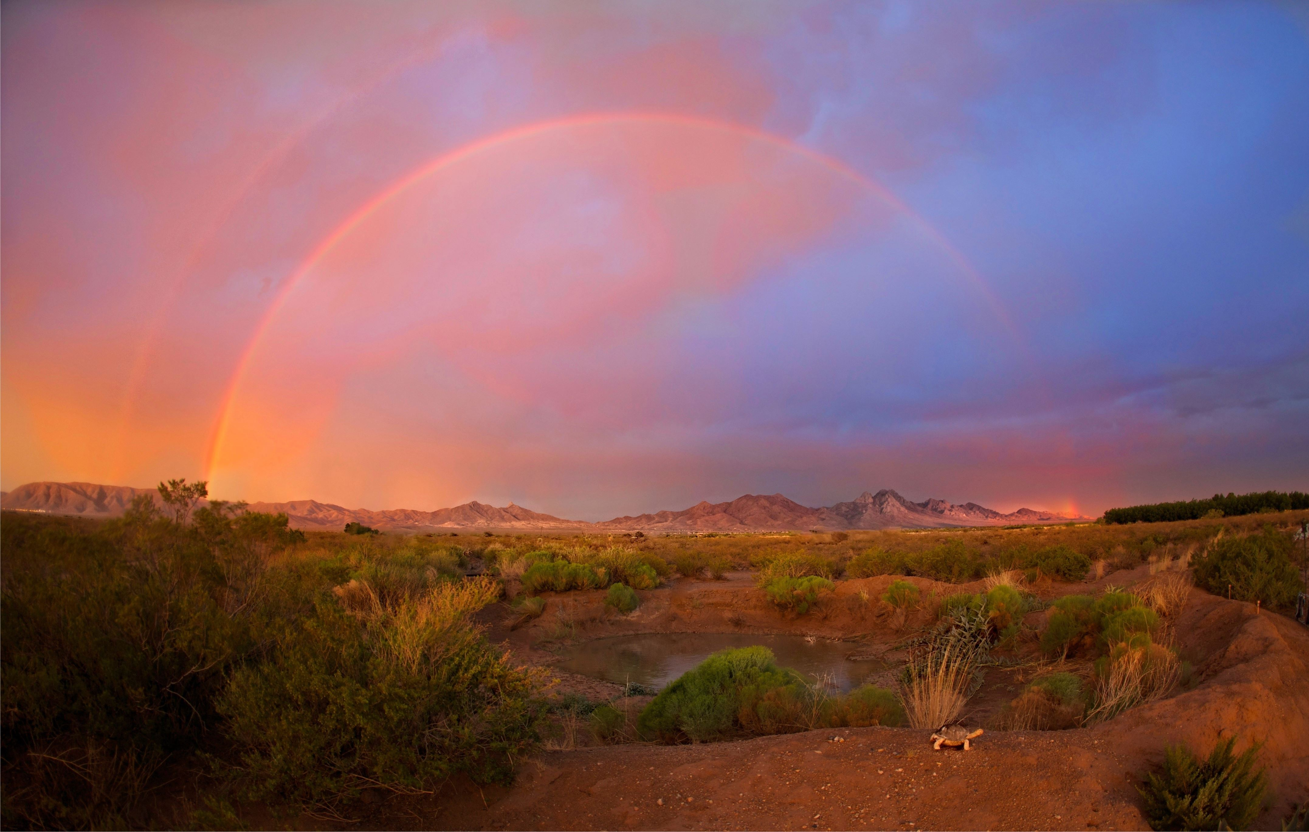 Slide 2 of 23: This rainbow and clouds were captured at Las Cruces, New Mexico.
