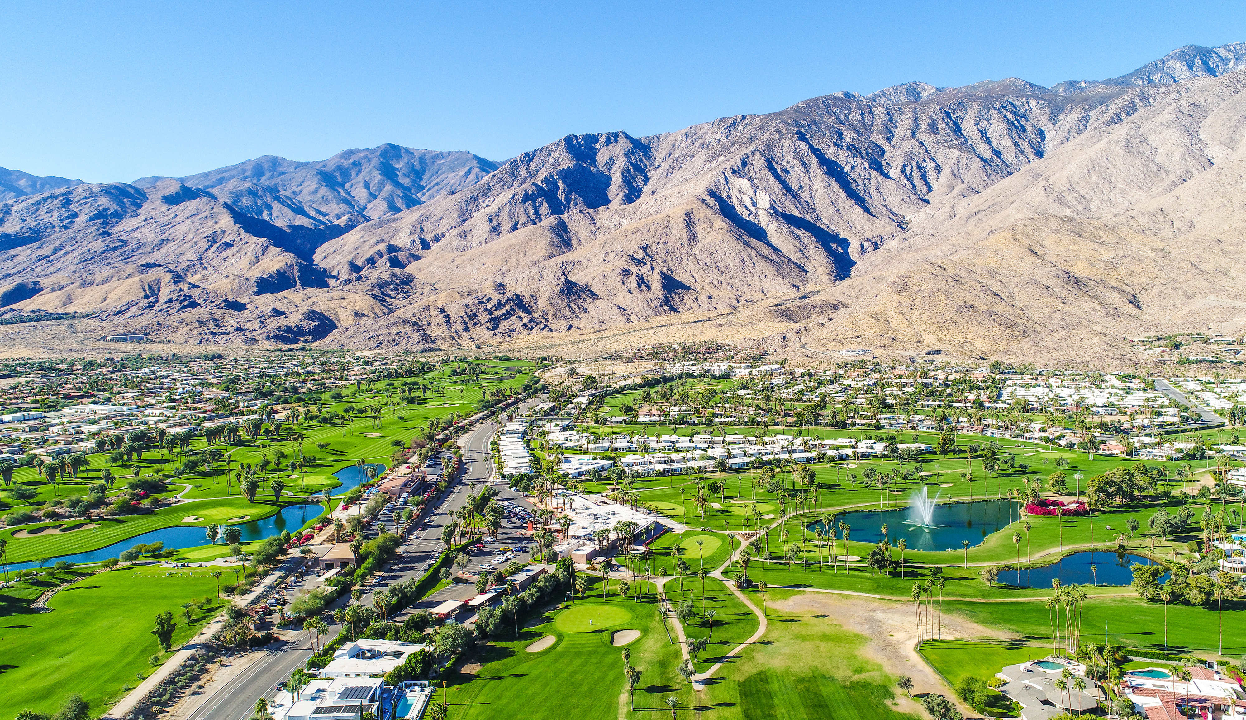 Slide 17 of 23: A beautiful aerial of Palm Springs and Palm Desert taking during a gorgeous blue-sky morning with 25+ miles of visibility.