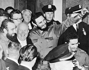 In this Sept. 20, 1960 file photo, Cuba's leader Fidel Castro, center holding a cigar, stands with Soviet Premier Nikita Khrushchev, center left, outside Hotel Theresa in Harlem, New York.