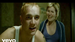a person posing for the camera: Music video by Eminem performing Stan. YouTube view counts pre-VEVO: 3,965,564. (C) 2002 Aftermath Entertainment/Interscope Records