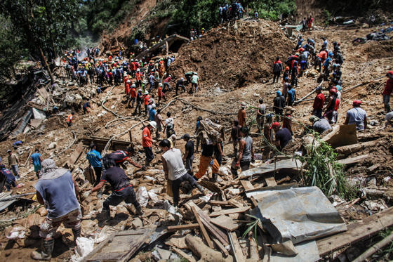 Slide 1 of 89: Filipino rescuers dig at the site where dozens of people were believed to have been buried by a landslide on September 18, 2018 in in Itogon, Benguet province, Philippines.