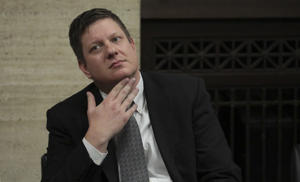 Chicago police Officer Jason Van Dyke listens while attorneys step before Judge Vincent Gaughan bench, as the jury has sent another question to Judge Gaughan, who read it aloud from the bench during deliberations in Van Dyke's trial at the Leighton Criminal Court Building, Friday, Oct. 5, 2018, in Chicago. Van Dyke is charged with first-degree murder, aggravated battery and official misconduct in the shooting of Laquan McDonald.