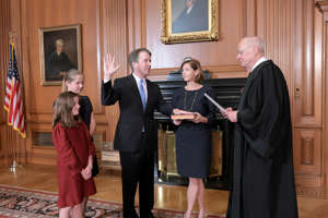Judge Brett Kavanaugh is sworn in as an Associate Justice of the U.S. Supreme Court by retired Justice Anthony M. Kennedy as his wife Ashley holds the bible and his daughters Liza and Margaret look on in a handout photo provided by the U.S. Supreme Court and taken at the Supreme Court building in Washington, U.S., October 6, 2018.