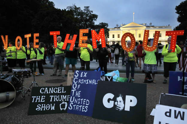 """Slide 1 of 72: People with the group Herndon Reston Indivisible hold up letters spelling """"VOTE THEM OUT"""" during a protest of the confirmation of Brett Kavanaugh to the Supreme Court, Saturday, Oct. 6, 2018, outside of the White House in Washington. (AP Photo/Jacquelyn Martin)"""