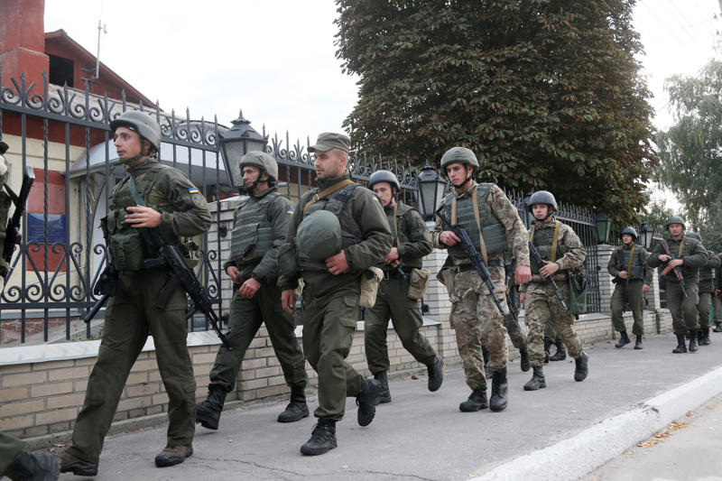 A file photo showing army soldiers patrol a street in the town of Kalynivka, Ukraine Wednesday, Sept. 27, 2017.
