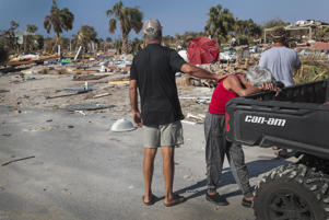 LeClaire Bryan (red shirt), mother of country music artist Luke Bryan, is comforted by James Whiddon after she becomes overwhelmed at the sight of her home after it was severely damaged by Hurricane Michael on October 19, 2018 in Mexico Beach, Florida. Hurricane Michael slammed into the Florida Panhandle on October 10, as a category 4 storm causing massive damage and claiming over 30 lives.