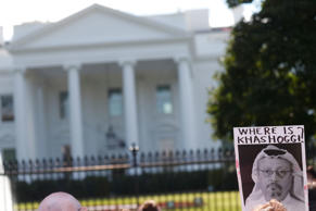 An activist holds an image of missing Saudi journalist Jamal Khashoggi during a demonstration calling for sanctions against Saudi Arabia and to protest Khashoggi's disappearance, outside the White House in Washington, U.S., October 19, 2018. REUTERS/Leah Millis