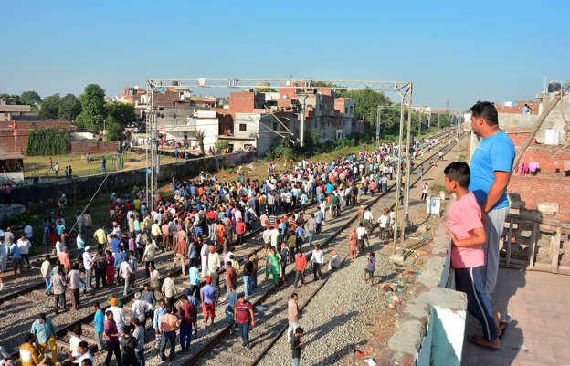 Train runs over crowd on tracks in northern India, 50 feared