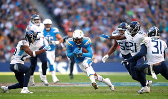 Chargers' Keenan Allen in action with Tennessee Titans' Logan Ryan, Jayon Brown, Malcolm Butler and David Fluellen on Oct. 21 in London.